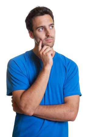 women thinking: Pensando hombre latino en una camisa azul