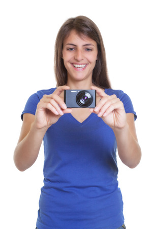 compact camera: Laughing tourist with compact camera taking a picture
