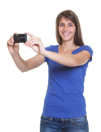 compact camera: Happy tourist with compact camera taking a picture Stock Photo