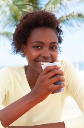 drinking soda: Brazilian woman at beach drinking soda