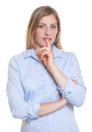 Thinking blonde german woman in blue blouse photo