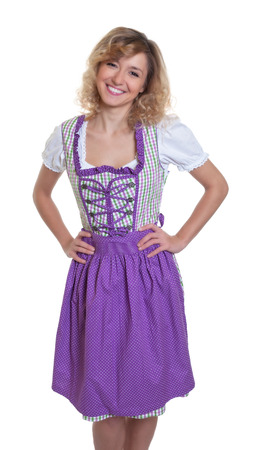 Standing bavarian woman with curly blonde hair Stock Photo