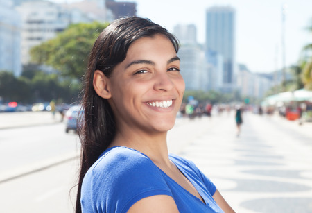 long dark hair: Happy latin woman with long dark hair in the city
