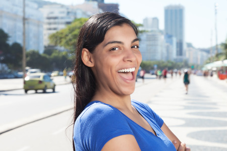 latina america: Funny latin woman with long dark hair in the city