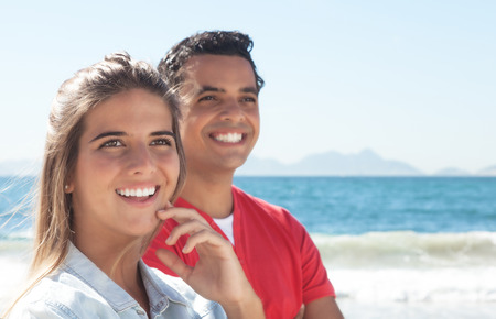 latin couple: Happy latin couple at beach