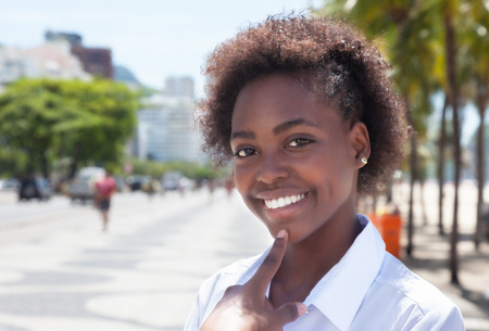 stylish woman: Laughing african american woman in the city