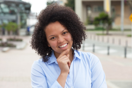 confident business woman: Laughing african american woman in the city