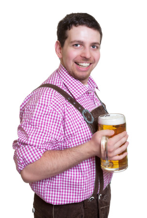 leather pants: Laughing bavarian guy with leather pants and a glass of beer