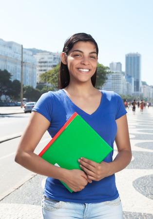 long dark hair: Standing latin student with long dark hair in the city Stock Photo