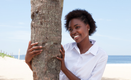 african american woman: Happy african american woman with a tree