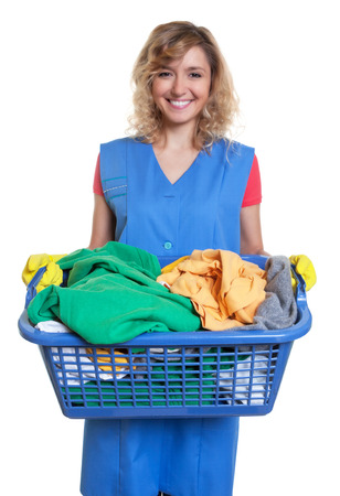 dirty clothes: Happy blonde housewife with dirty clothes Stock Photo