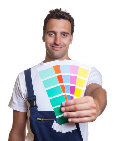 pintor: Sonre�r colores pintor mostrando Foto de archivo