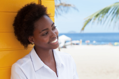 toothy smiles: African american girl near beach in love Stock Photo