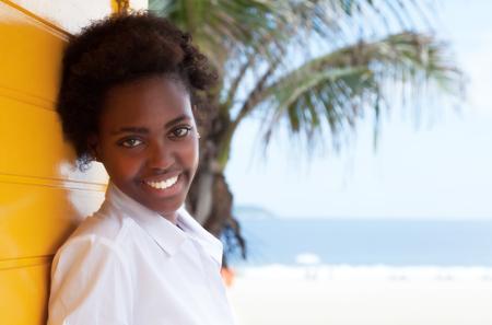 latina america: Beautiful african american girl near beach