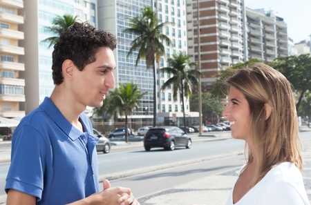 latina america: Mexican guy talking with girlfriend in the city