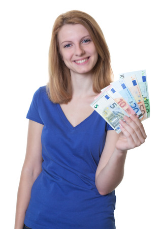 win: Young woman with red hair showing money