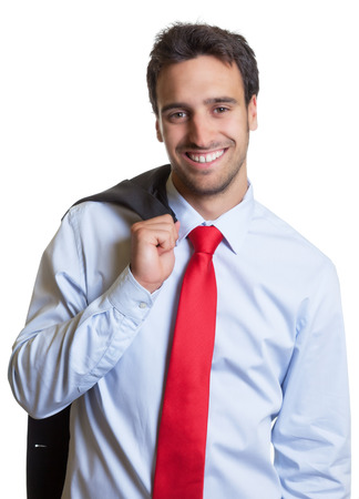 after work: Laughing latin businessman with red tie after work Stock Photo