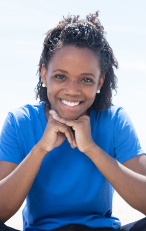 latin american: Cool african american woman in a blue shirt