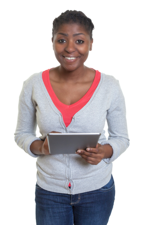 latina america: Laughing african american woman with tablet