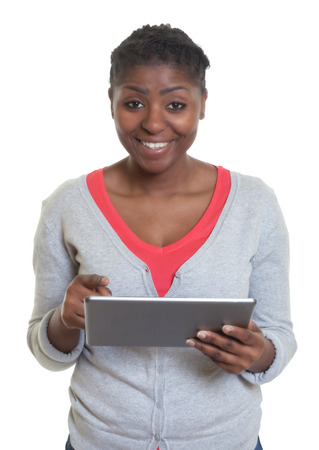 african american woman: African american woman working with tablet