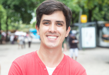 red shirt: Young caucasian guy with red shirt in city