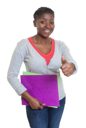 african student: African american student with paperwork showing thumb Stock Photo