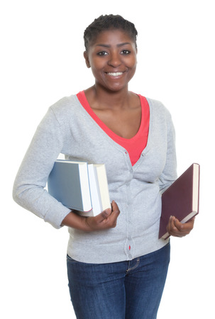 african student: Happy african american student with books