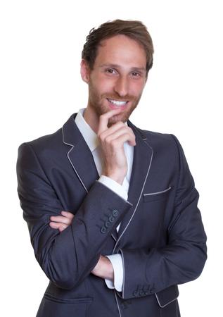 trusty: Laughing german businessman with dark Stock Photo