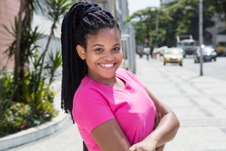 jamaican adult: Laughing latin woman in a pink shirt Stock Photo