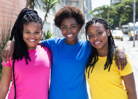 Three beautiful african american girlfriends in the city Foto de archivo