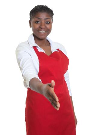 salesgirl: Beautiful african american waitress reaching hand for handshake