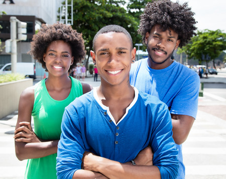 Group of african american young adults with crossed arms