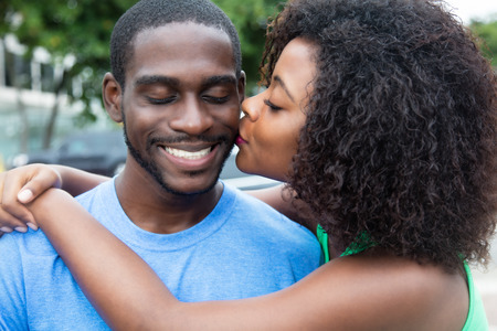 africa kiss: Kissing african american couple Stock Photo