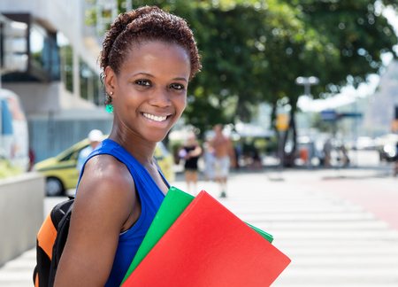 african student: African american female student with short hair in city Stock Photo