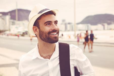 looking around: Tourist with hat looking around in vintage warm cinema look