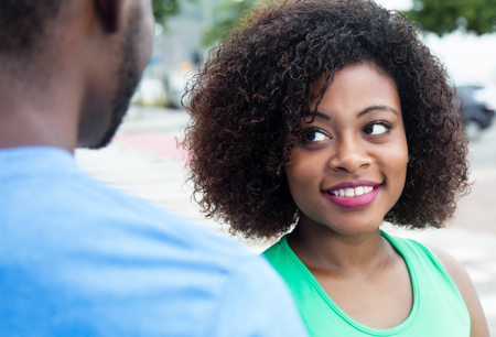 african american woman: African american woman flirting with husband Stock Photo
