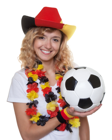 female soccer: German female soccer fan with hat and ball Stock Photo