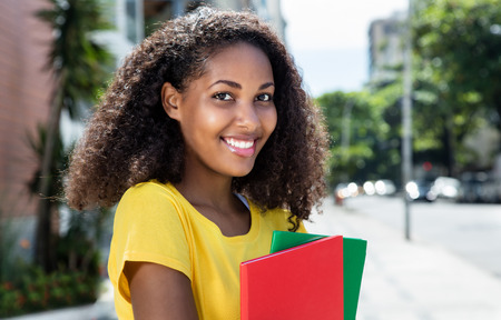 hispanic girl: Beautiful latin female student  with curly in summer Stock Photo
