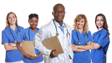 latina america: Smiling african doctor with 4 nurses Stock Photo