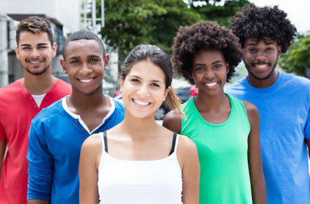 multiethnic: Laughing caucasian girl with group of multiethnic friends