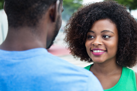 african american woman: African american woman talking with husband