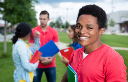 african student: African american male student and multiethnic friends