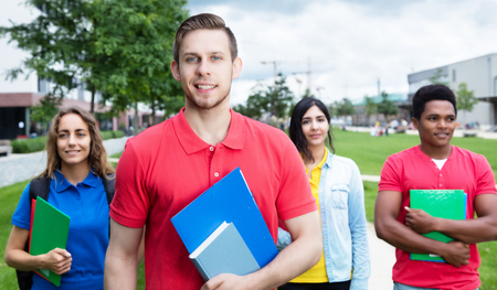 multiethnic: Caucasian male student with stubble and multiethnic friends Stock Photo
