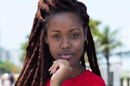dreadlock: Sensual african woman with dreadlocks in the city Stock Photo