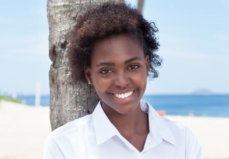 african american woman: Beautiful african american woman at beach