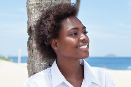 african american woman: Happy african american woman at beach Stock Photo
