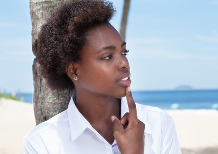 sensitive: Sensitive african american woman at beach Stock Photo