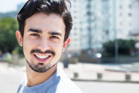 cool guy: Cool hispanic guy in a grey shirt in city Stock Photo