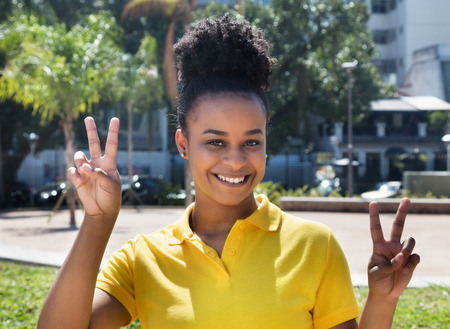 chilean: Beautiful woman with amazing hairstyle showing victory sign