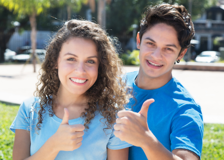 north american: North american couple showing thumbs up Stock Photo